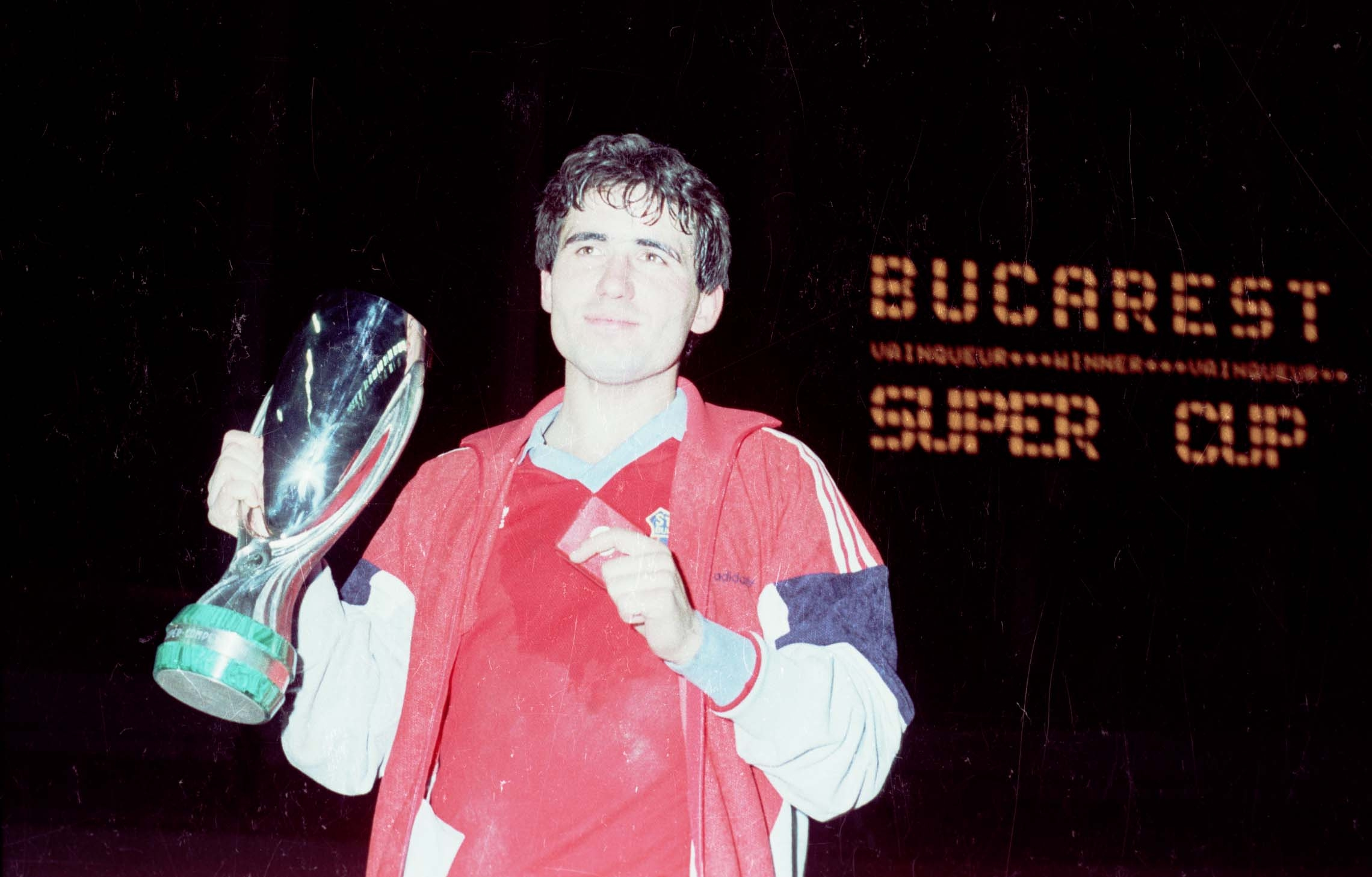 Gheorghe Hagi posing with the UEFA Super Cup, a trophy won thanks to his free kick goal against Dinamo Kiev, on February 24th 1987